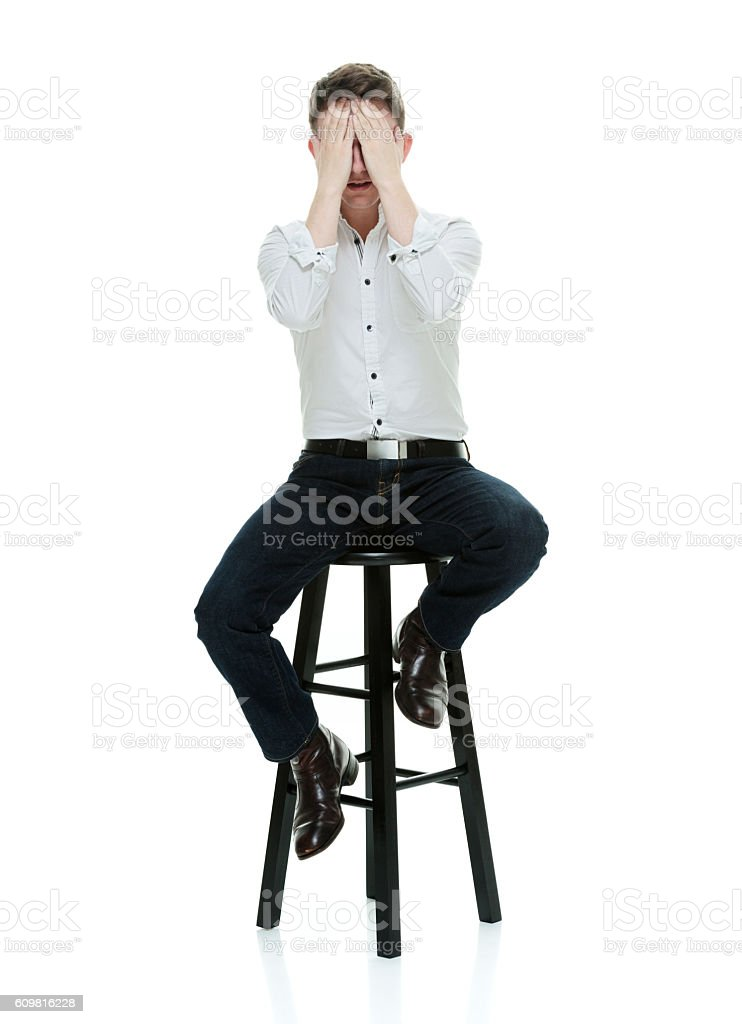 Casual man covering his eyes stock photo