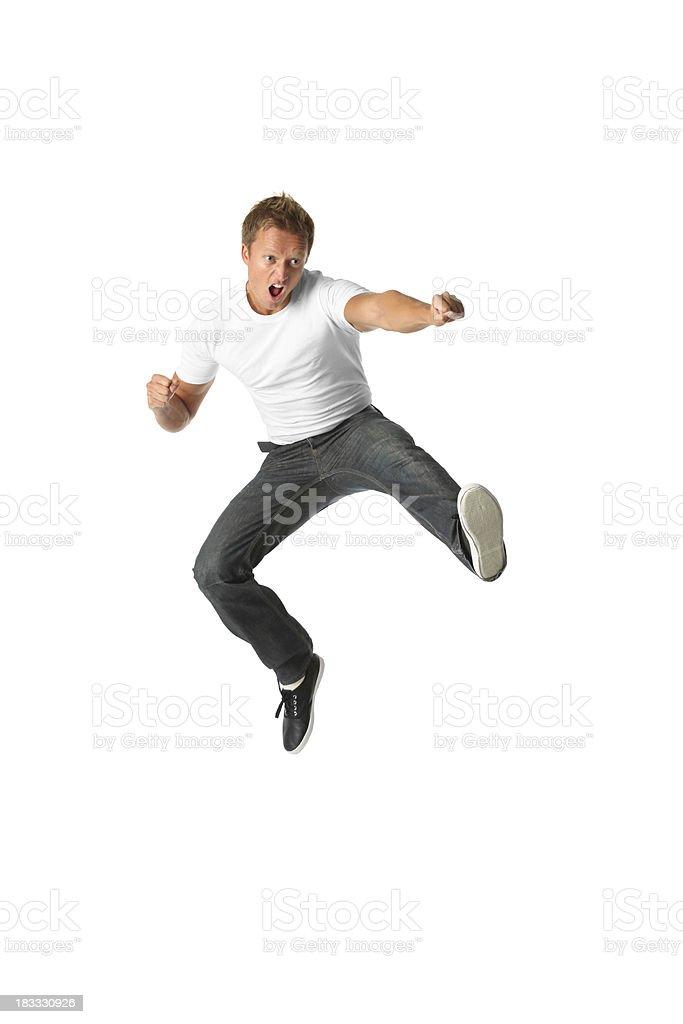 Casual man flying kick karate stock photo