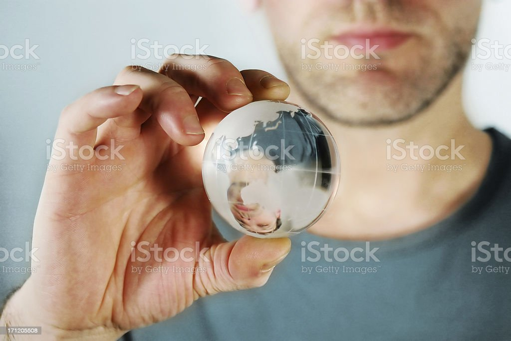 Casual man holding a crystal world royalty-free stock photo