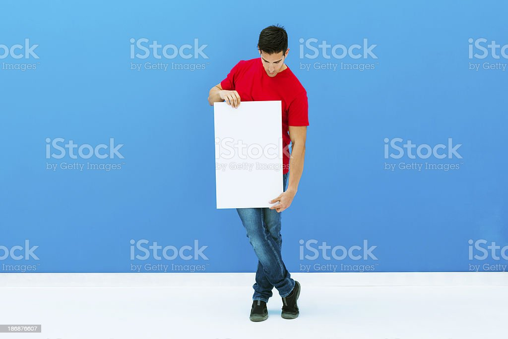 Casual man holding blank placard royalty-free stock photo
