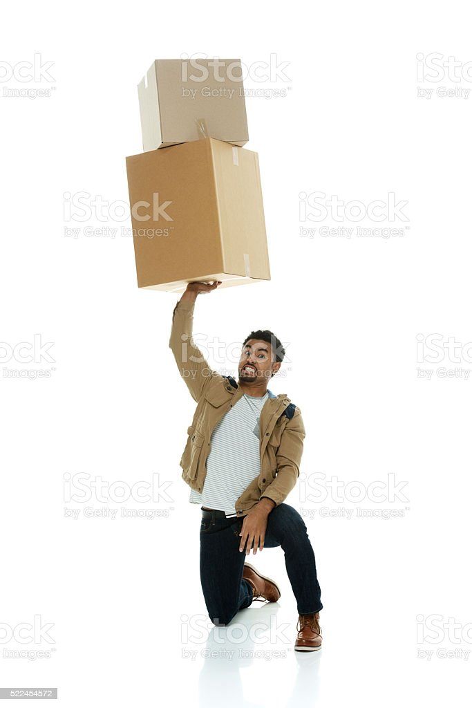 Casual man holding box stock photo