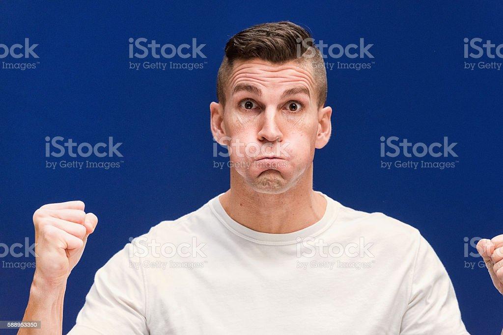 Casual man holding breath stock photo
