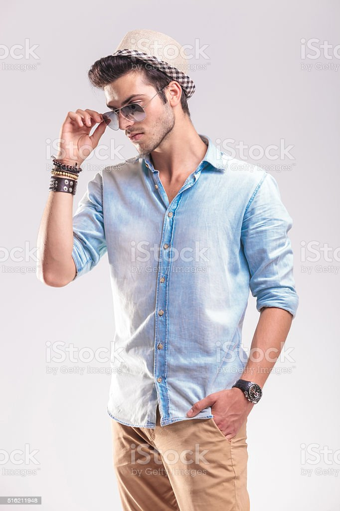 casual man holding one hand in his pocket stock photo