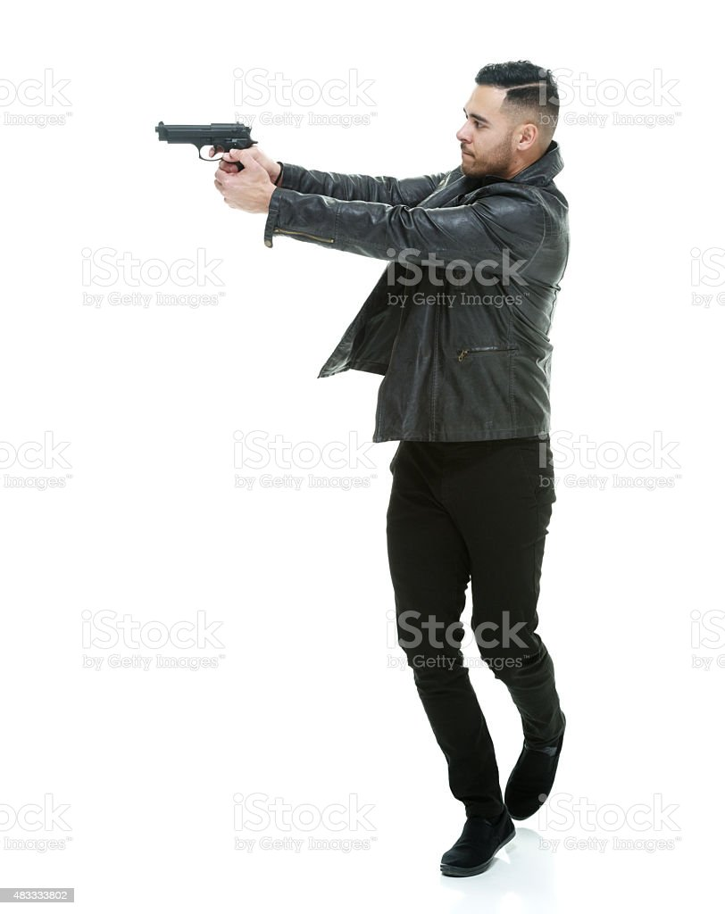 Casual man in action with handgun stock photo