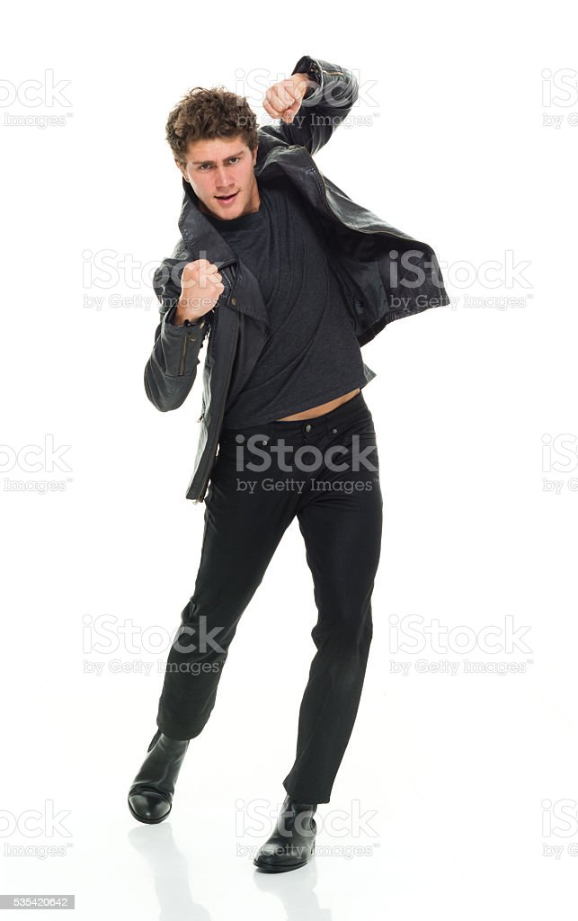 Casual man in fighting stance stock photo