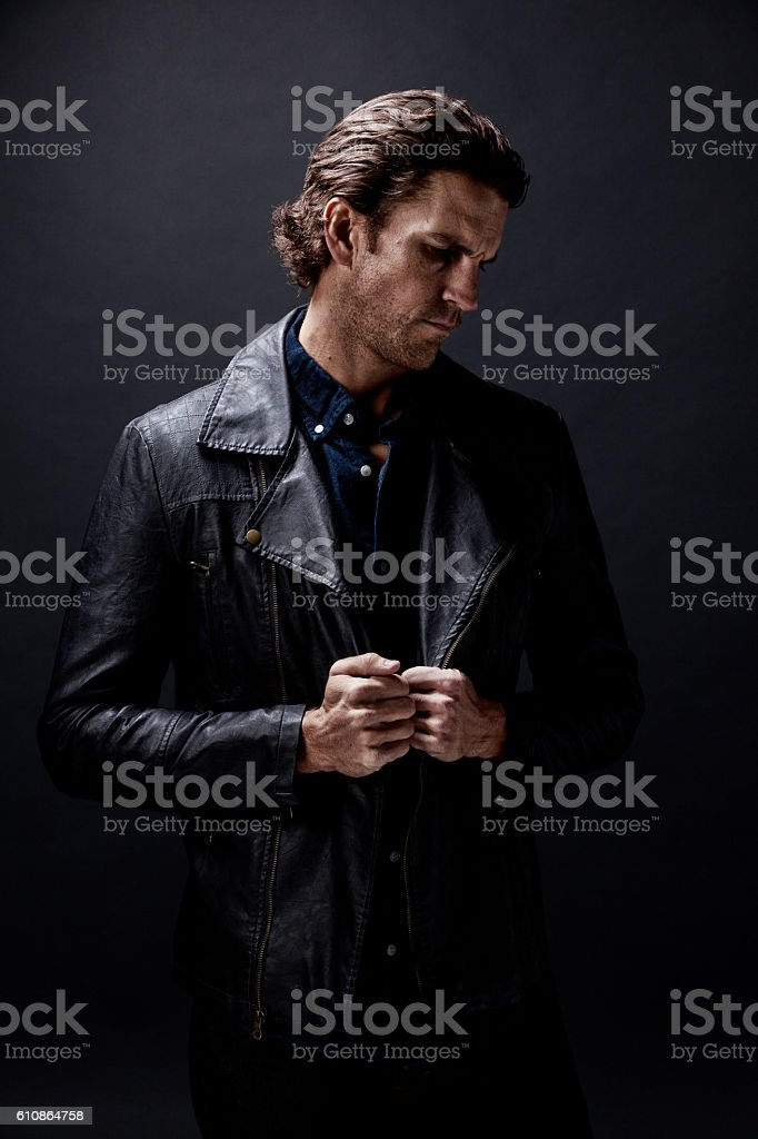 Casual man looking down stock photo