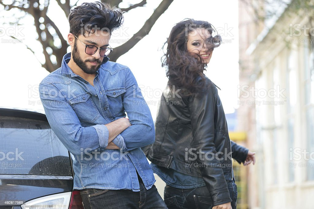 casual man looks down beside turned girl stock photo
