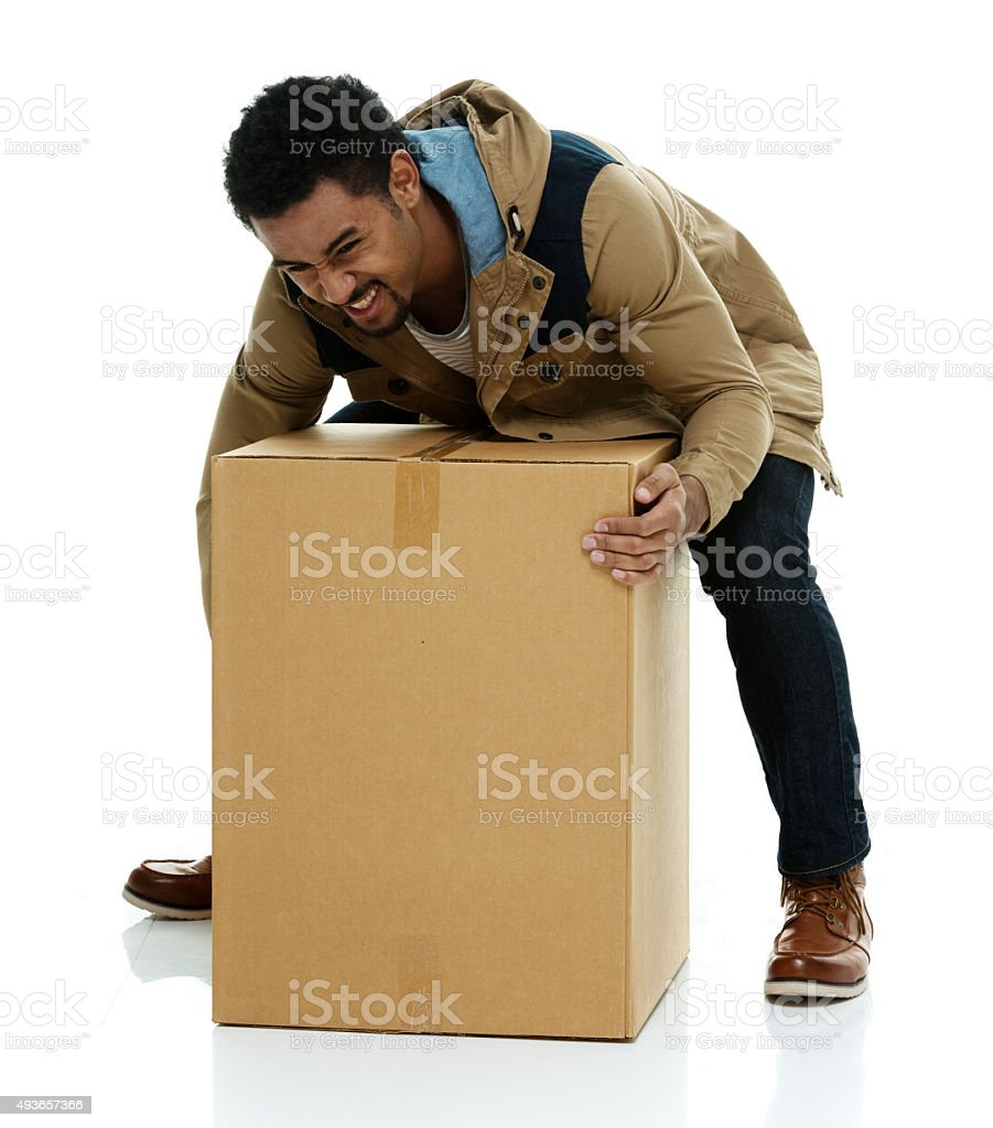 Casual man picking up package stock photo