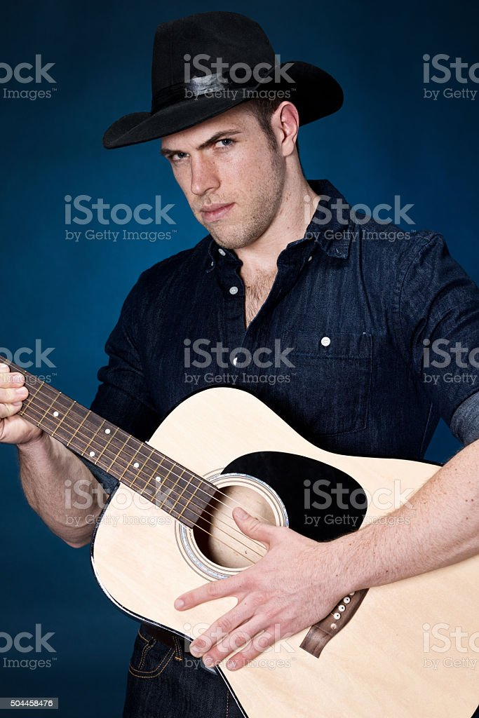 Casual man playing guitar stock photo