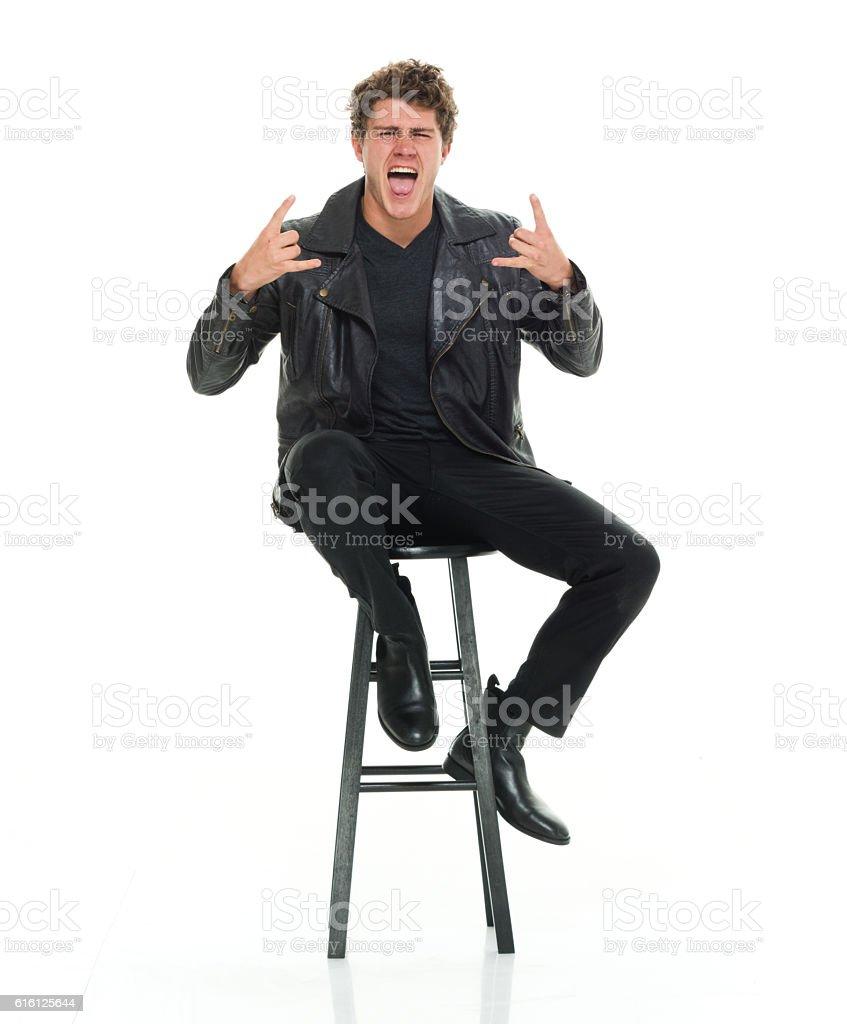 Casual man shouting and giving shaka sign stock photo