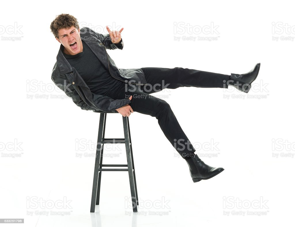 Casual man showing shaka sign and being silly stock photo