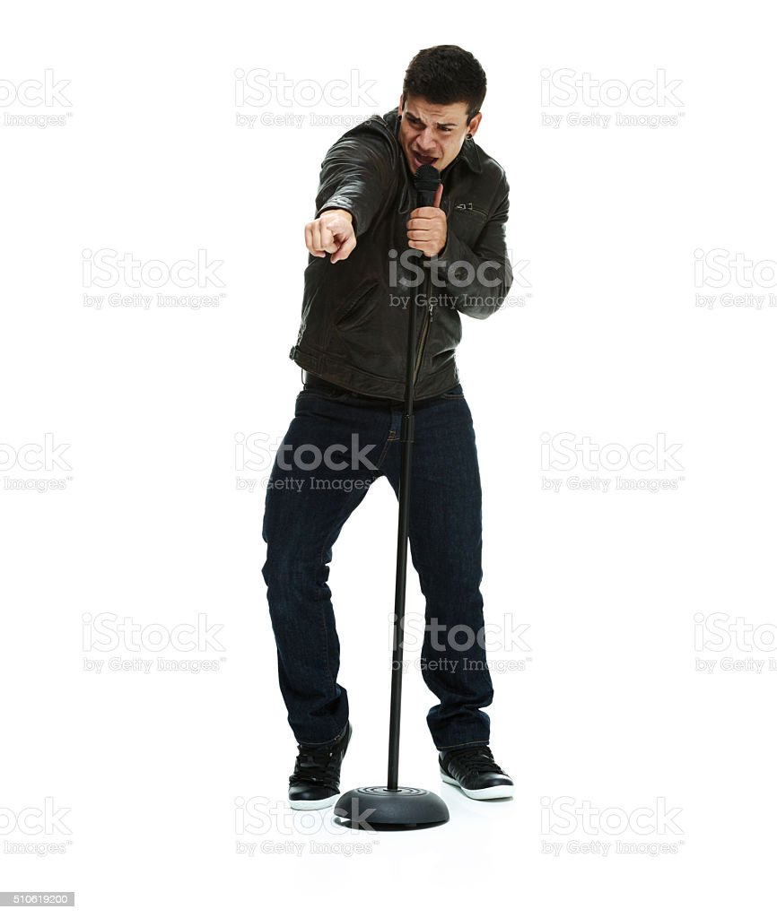 Casual man singing song with microphone stock photo