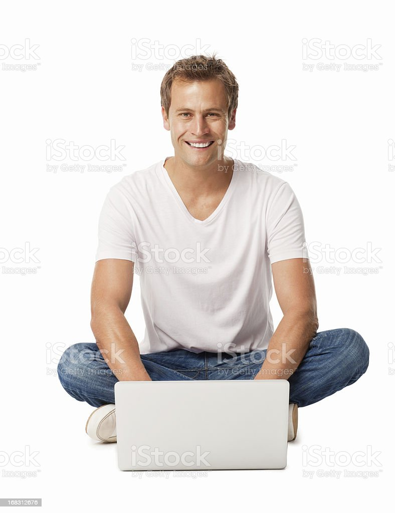 Casual Man Sitting On Floor Using Laptop - Isolated royalty-free stock photo