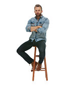 Casual man sitting with arms crossed on stool