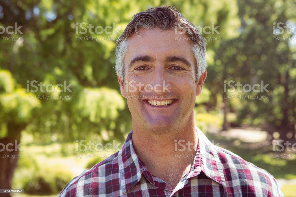 Casual man smiling at camera stock photo