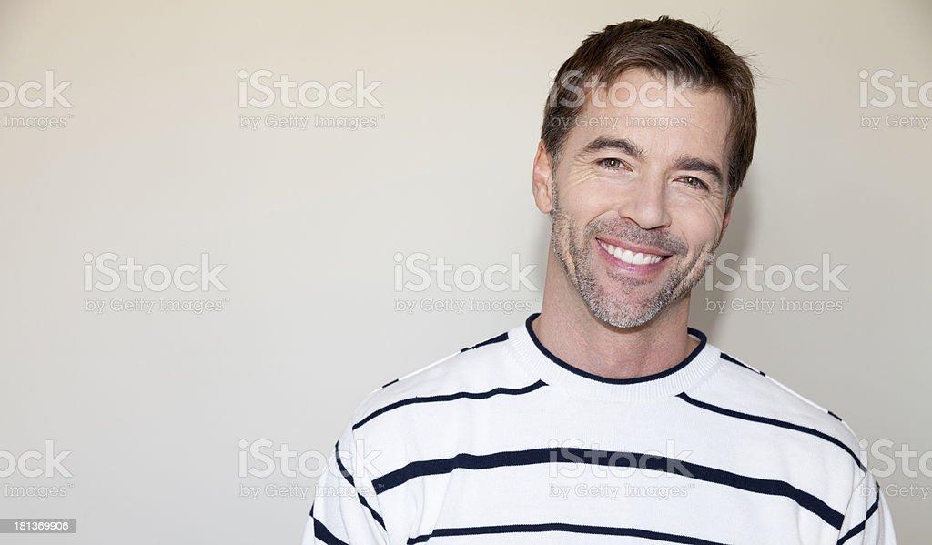 Casual Man Smiling At The Camera royalty-free stock photo