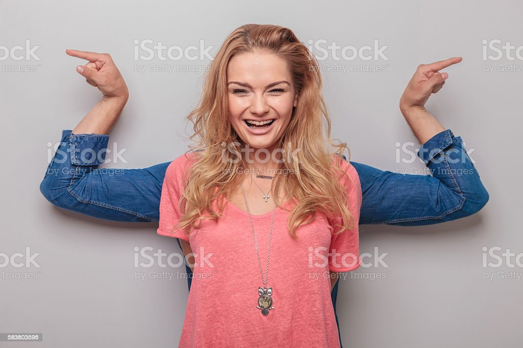 Casual man standing behind his girlfriend stock photo