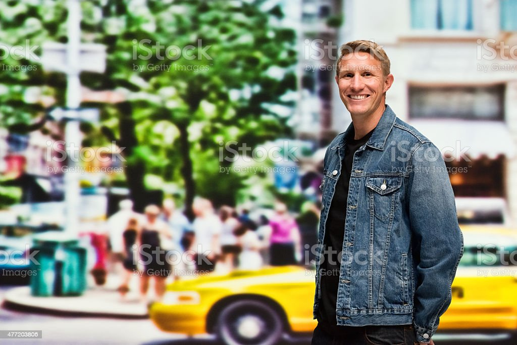 Casual man standing on road stock photo