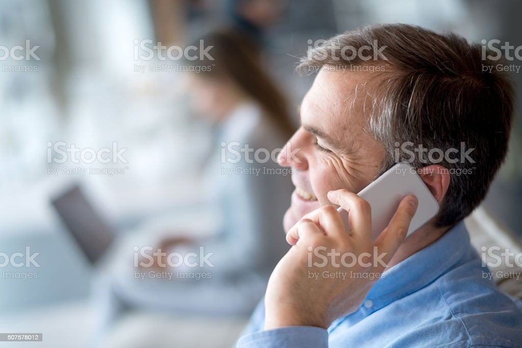 Casual man talking on the phone stock photo