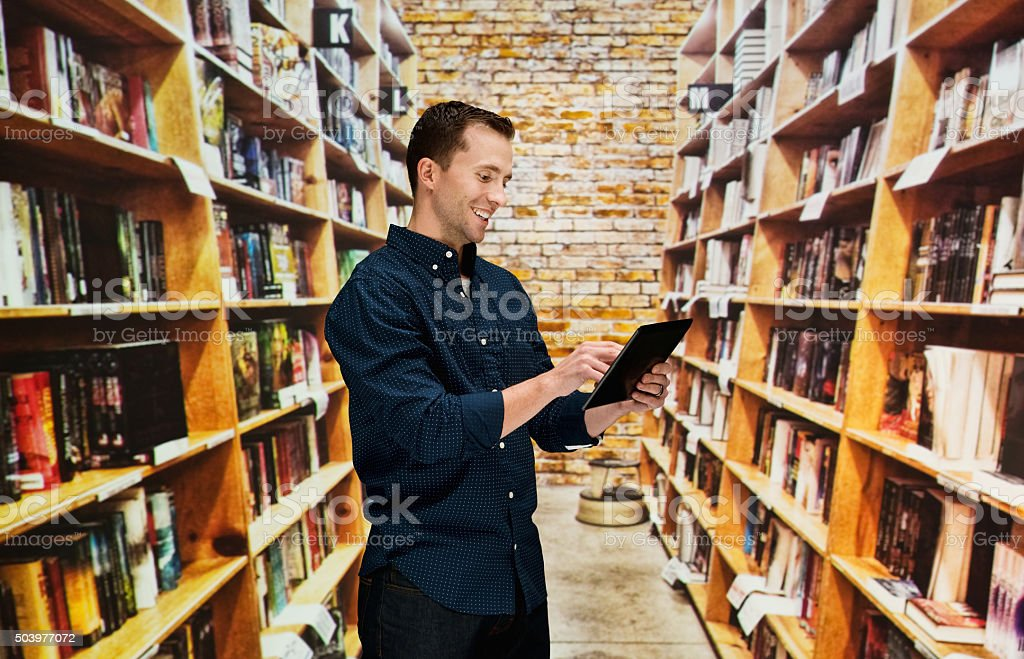 Casual man using digital tablet stock photo