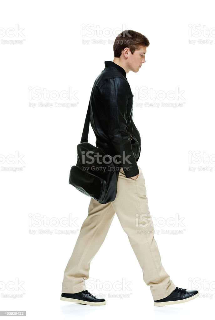 Casual man walking and looking away stock photo