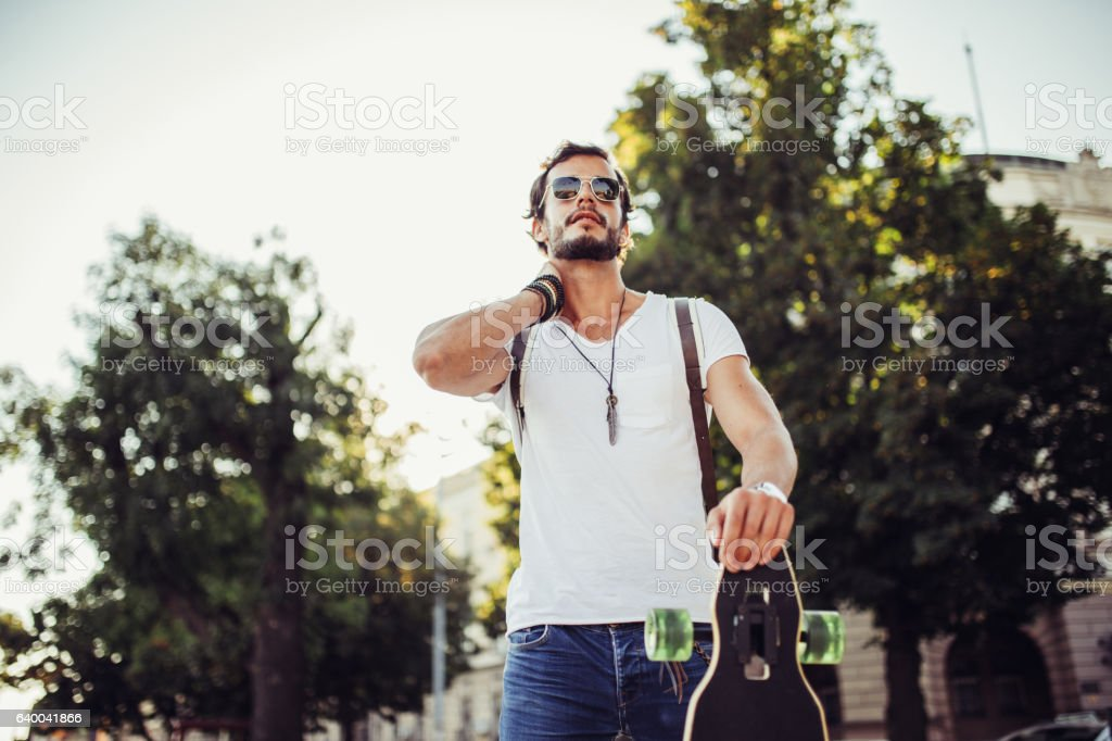 Casual man walking on the street stock photo