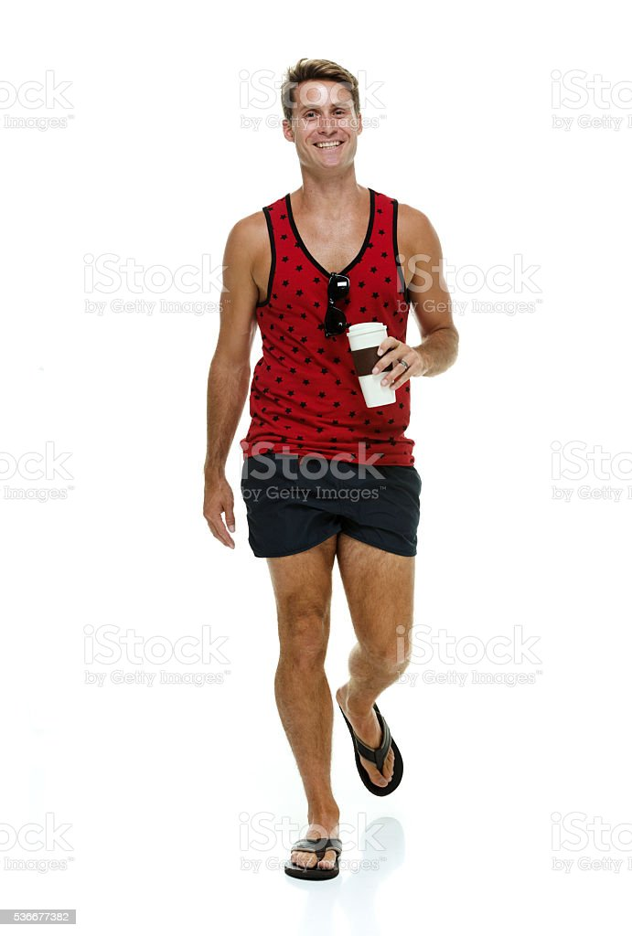 Casual man walking with coffee cup stock photo