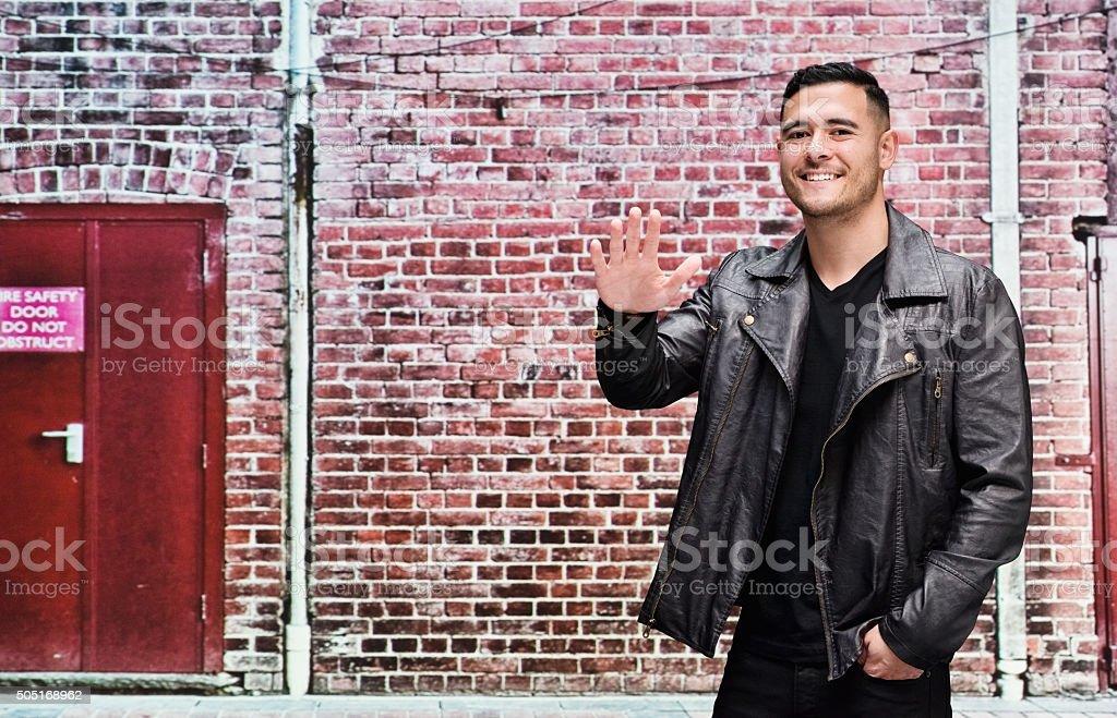 Casual man waving hand stock photo