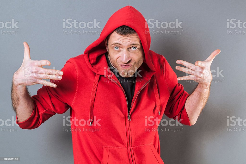 casual man with a hoodie playing like a fun rapper stock photo