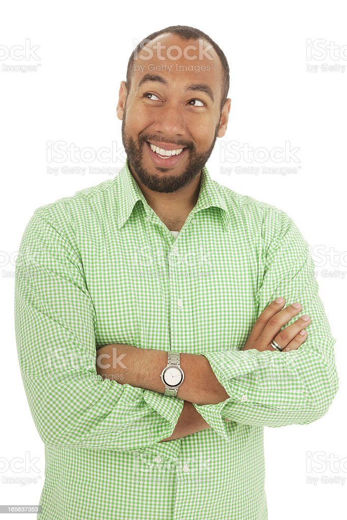 Casual Man with Arms Crossed Looking Up royalty-free stock photo
