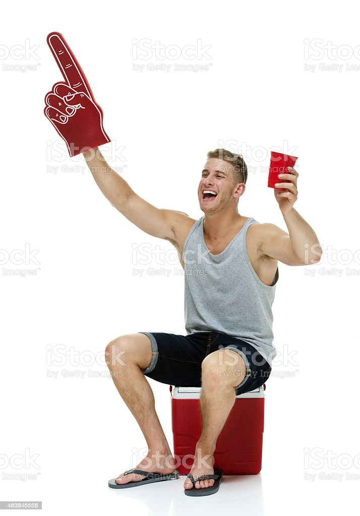 Casual man with foam finger stock photo