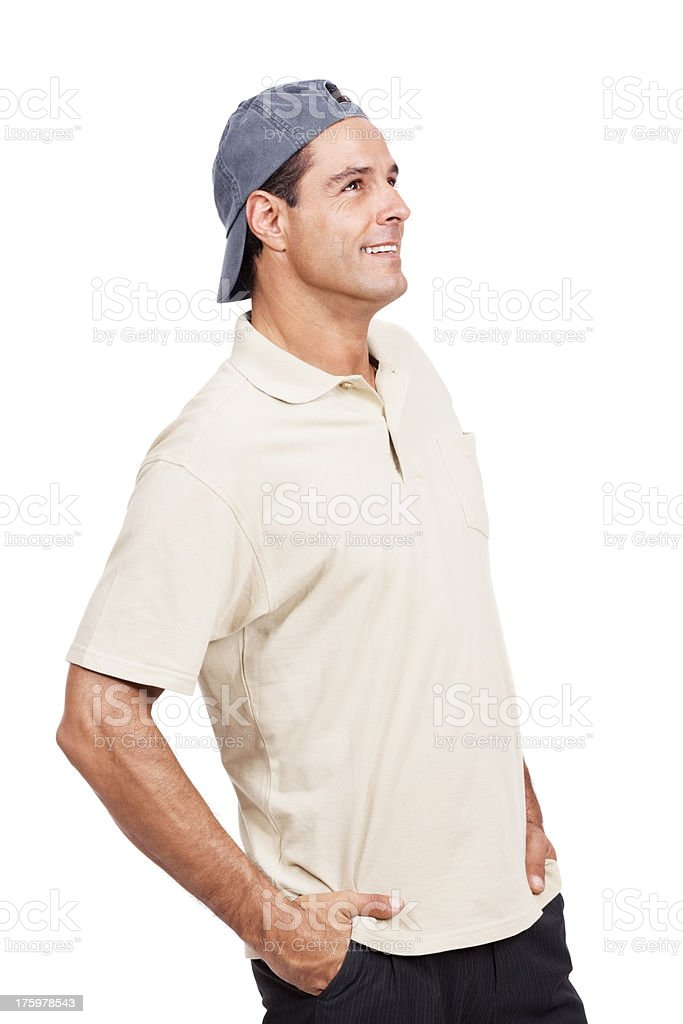 Casual man with hands in pocket looking away at copyspace stock photo
