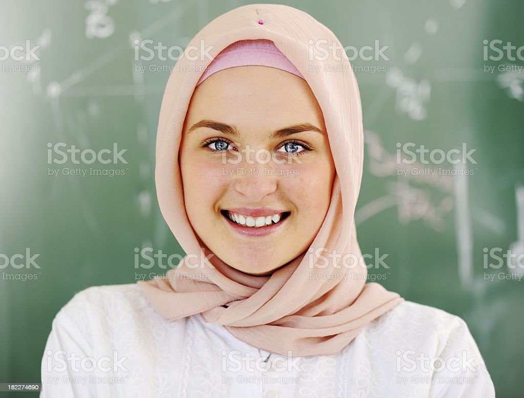 Casual Muslim Arabic student looking happy and smiling stock photo