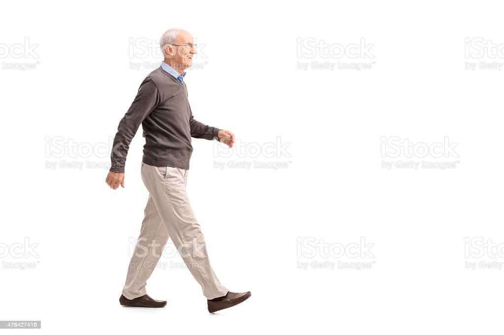 Casual senior man walking and smiling stock photo