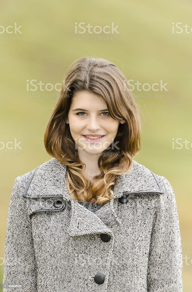 Casual smiling cute teenager girl portrait stock photo