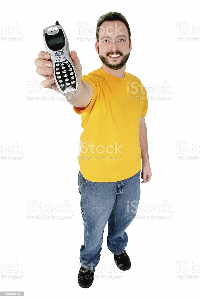 Casual Smiling Man Handing Cordless House Phone royalty-free stock photo