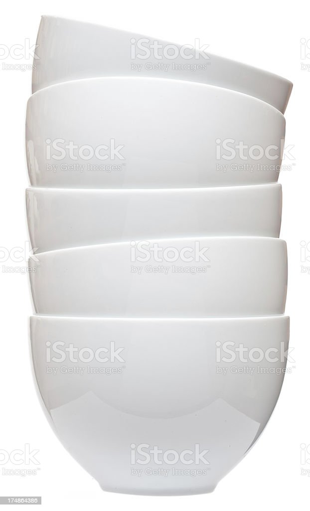 Casual stack of five white ceramic bowls royalty-free stock photo
