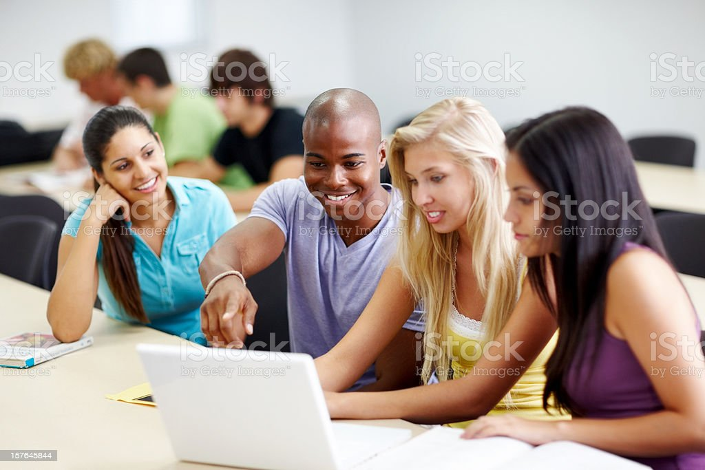 Casual students in classroom using laptop royalty-free stock photo
