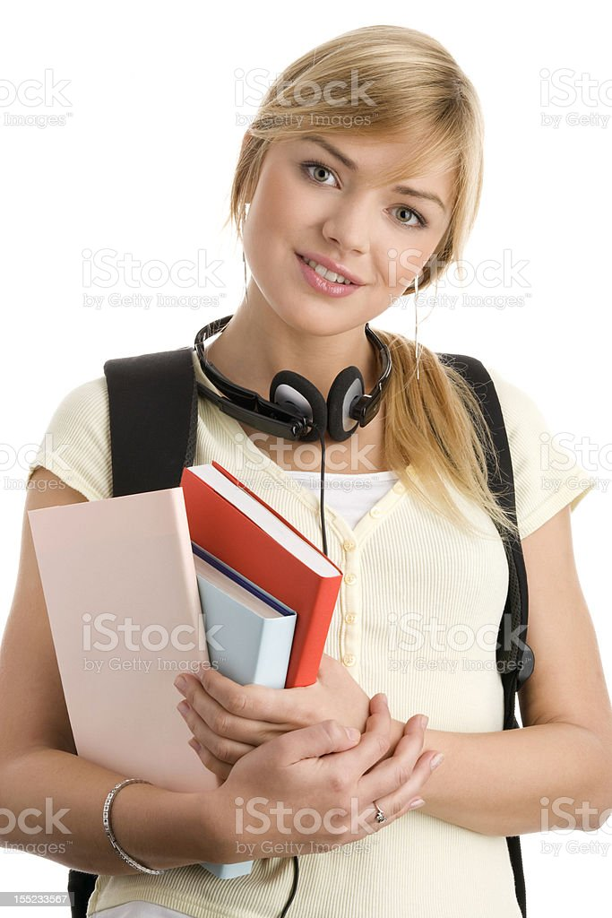 Casual teenage girl holding books royalty-free stock photo