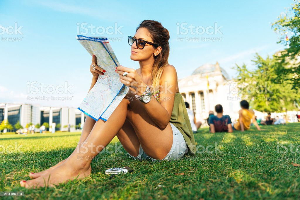 Casual tourist with map sitting near Bundestag- German Parliament stock photo