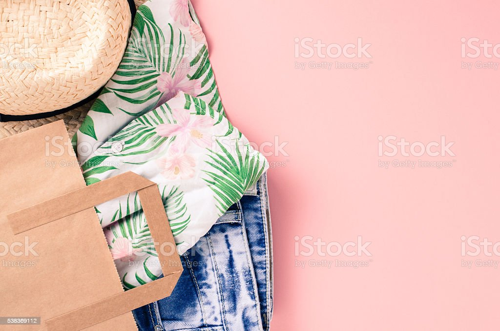 Casual woman clothes in paper shopping bags stock photo