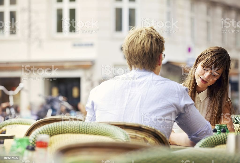 Casual Woman Having a Conversation with Her Date royalty-free stock photo