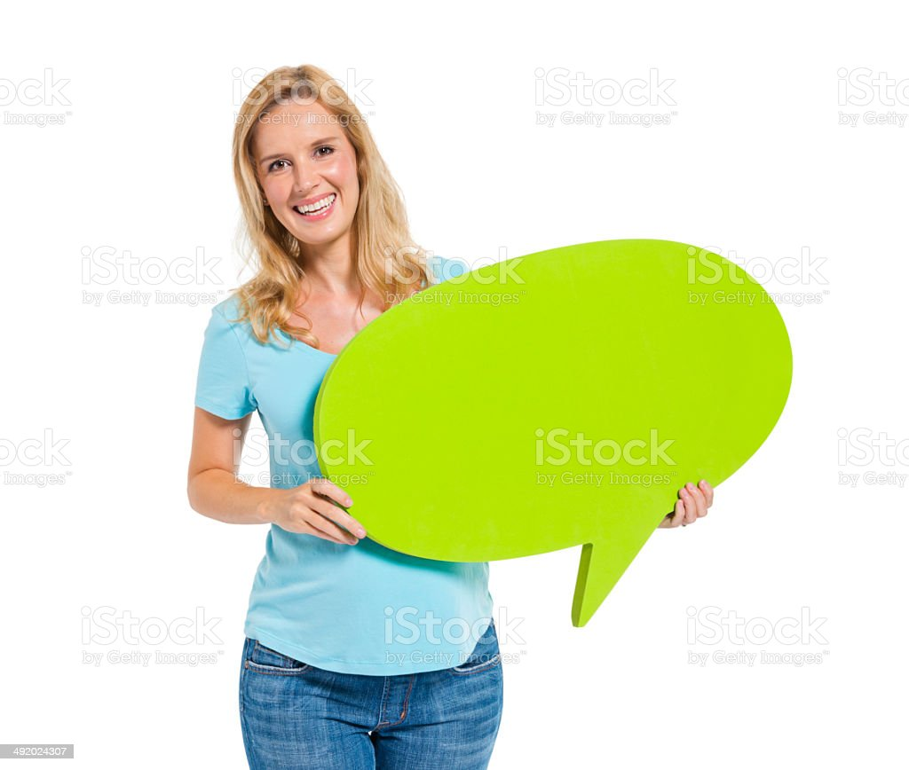 Casual Woman Holding Speech Bubble stock photo