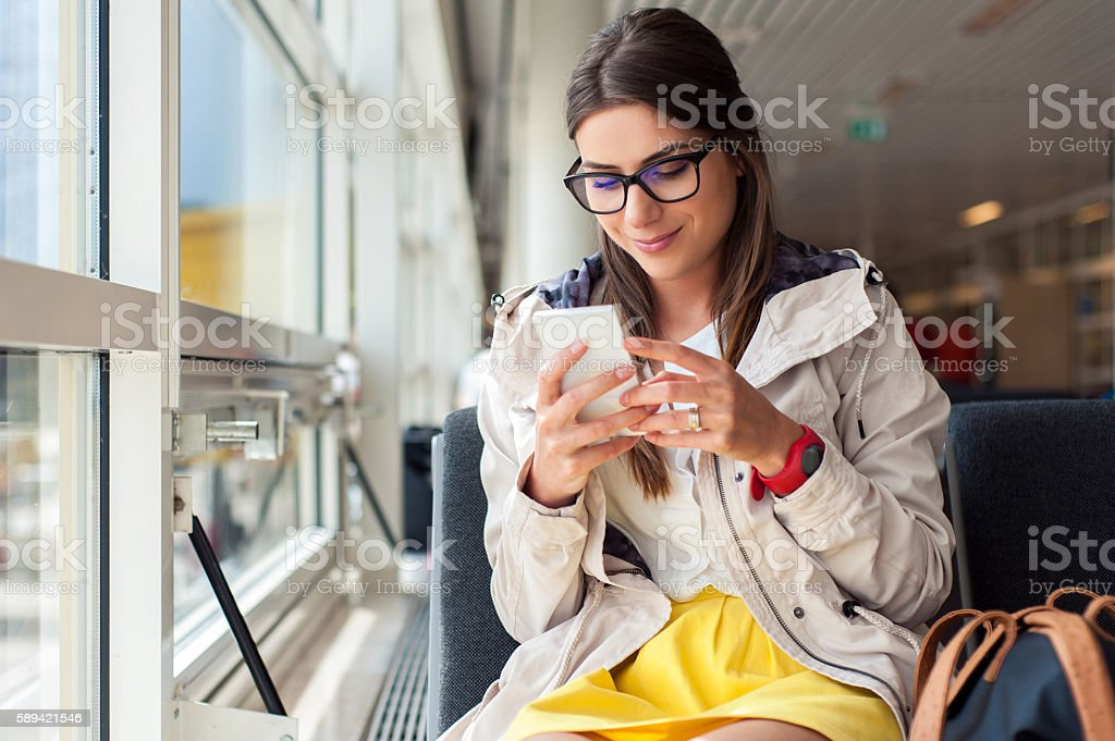 Casual woman in airport hall. stock photo
