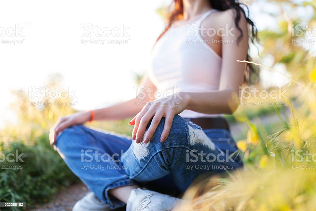 Casual Woman Meditating In Nature stock photo