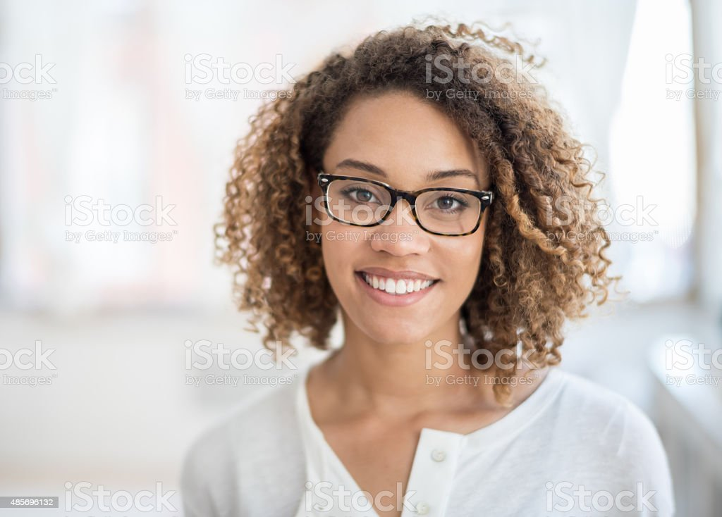 Casual woman portrait wearing glasses stock photo