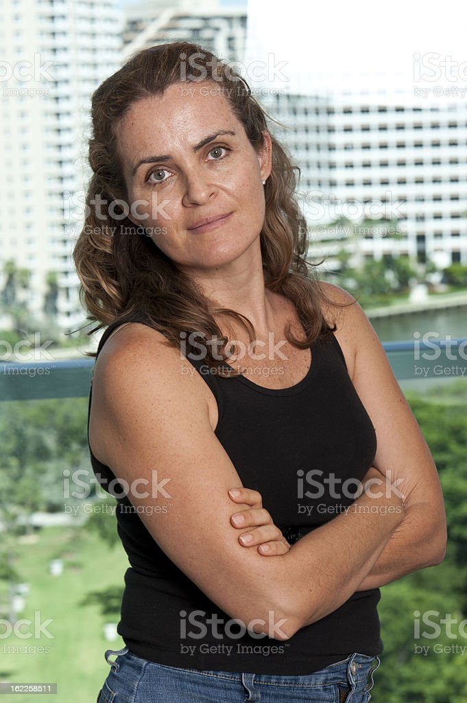 casual woman posing in a city royalty-free stock photo