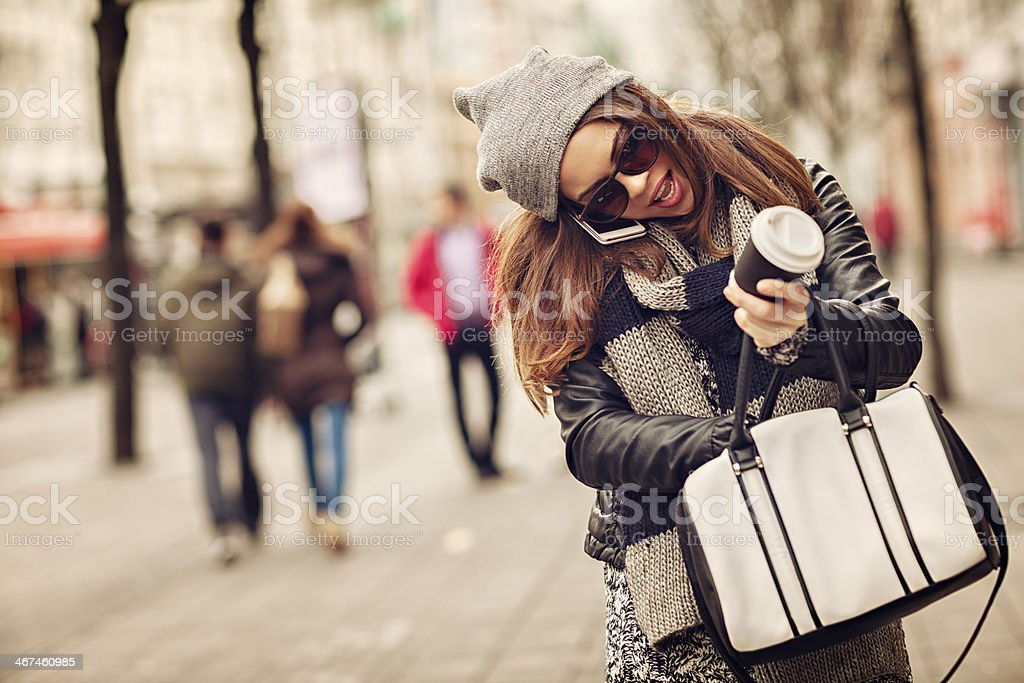Casual woman talking on mobile phone stock photo
