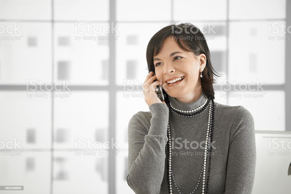 Casual woman talking on phone stock photo