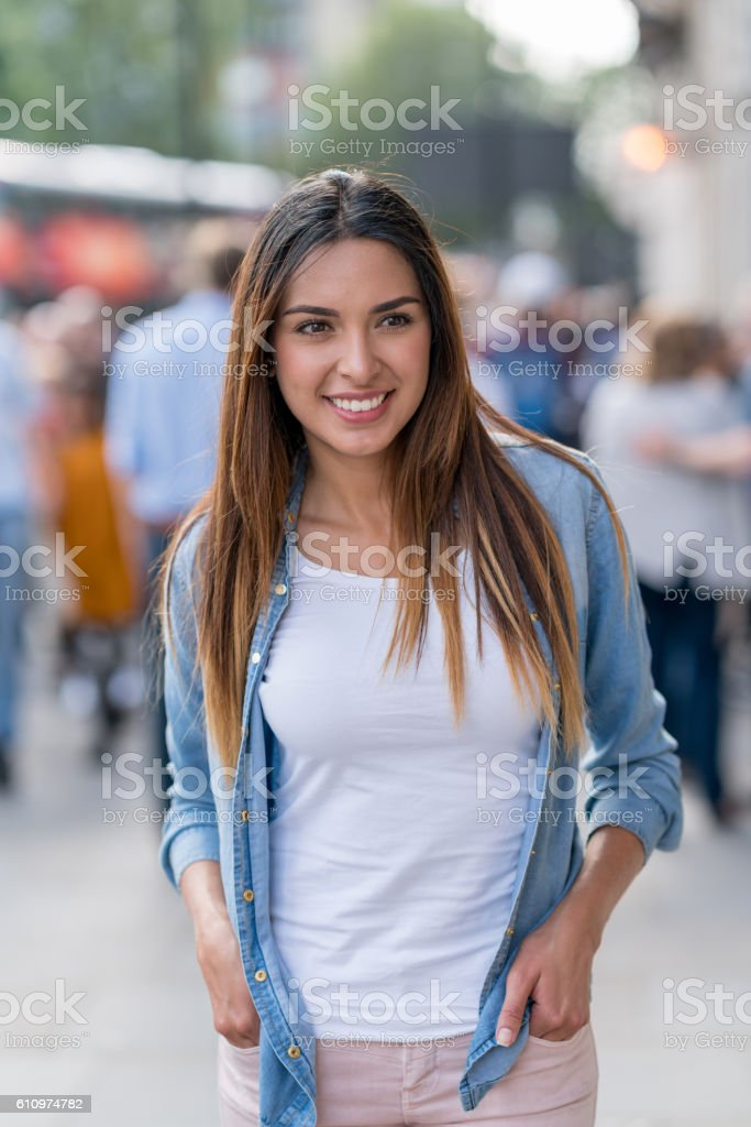 Casual woman walking in the city stock photo